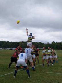 Dave Shipman goes up on a line out