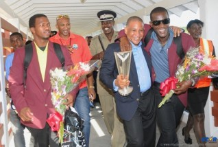 West Indies won the T20 World Cup and following their return home Captain Darren Sammy (r) pictured with former West Indies Cricket Board CEO Ernest Hilaire and teammate Johnson Charles (l) received a heroes welcome.