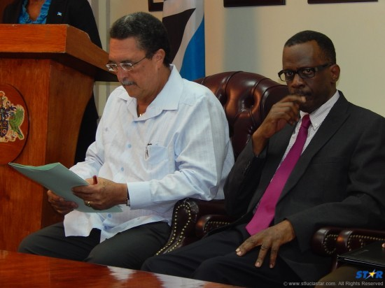 Prime Minister Kenny Anthony and infrastructure Minister Phillip J Pierre with their report card on the trough. It included nothing on the radar confusion or on the Virgin Atlantic mishap.