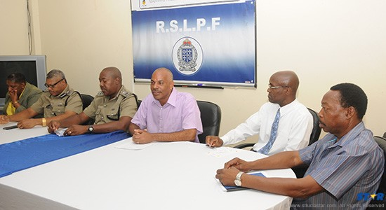 Police Commissioner Vernon Francois (fourth from the left) with high ranking officers and President of the St Lucia National Cricket Association Julian Charles (seated on his left) at a recent press conference.
