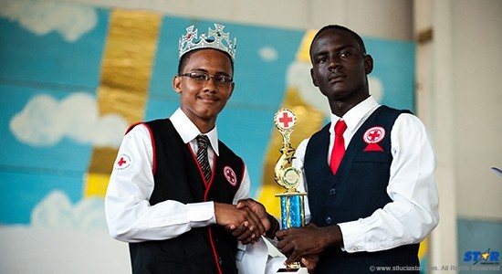 Asa Willie (left): The form 4 student of CCSS is presented with his trophy.