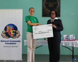 Cheque handover by EC Global to the NCF.