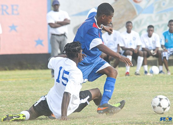 A Mon Repos player gets past a sprawling Central Castries defender during Saturday's semi-final game.