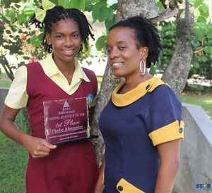 Top achiever of the Soufriere Comprehensive Secondary School, Phebe Alexander with teacher Delia Herelle.