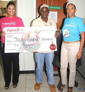 $10,000 Christmas winner Julian Eugene with Digicel's Sergin John Baptiste and Natasha Meda.