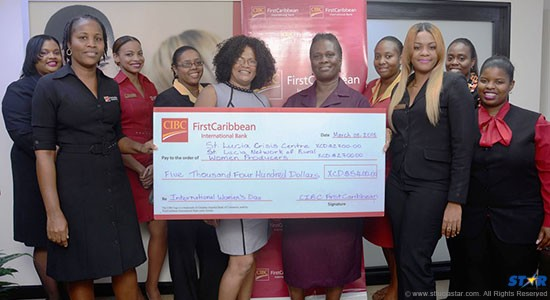 Reps from St. Lucia Crisis Centre & St Lucia Network of Rural Women Producers with CIBC FirstCaribbean employees.