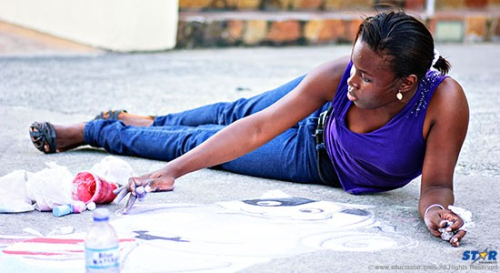 For the love of art: this young lady gets right into it on the sidewalk of the Baywalk Mall. (Photos by Bill Mortley)