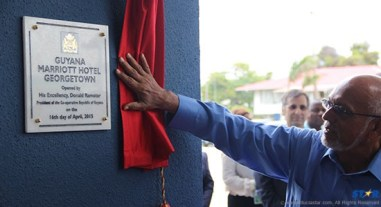 President Donald Ramotar unveils the plaque at the opening of the Marriott in Guyana.