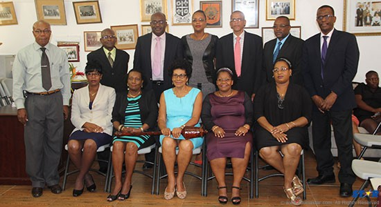 Shirley Lewis (holding mace) surrounded by newly appointed council members. Standing: Harold Dalsan (extreme left) and Phillip J Pierre (extreme right).