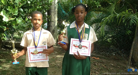 Sportsman and Sportswoman of Year at Des Barras Combined School proudly displaying their awards and certificates.