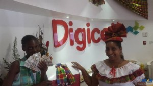 Two of the winners, Nattalie Neptune and Cleveland Simon, collect their prizes from Digicel representatives.