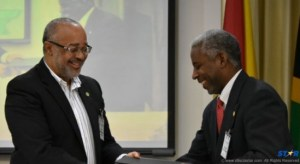 Dr. Didacus Jules, Director General of the OECS Commission (left), with Nigel Cassimire, acting Secretary General of the Caribbean Telecommunications Union, at the signing of a memorandum of understanding between the OECS and the CTU in Tortola, BVI on September 30, 2015.