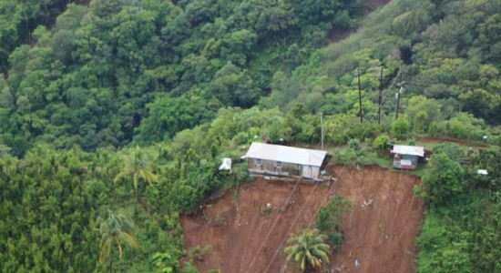 A house in Dominica perched precariously after Tropical Storm Erika. Caribbean leaders say climate change is already wreaking havoc on small islands. Photo: teleSUR