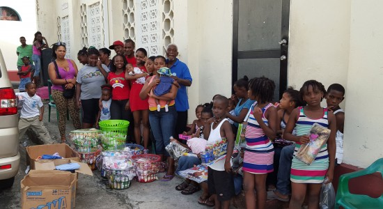 The Wave team with volunteers and recipients of toys and hampers.