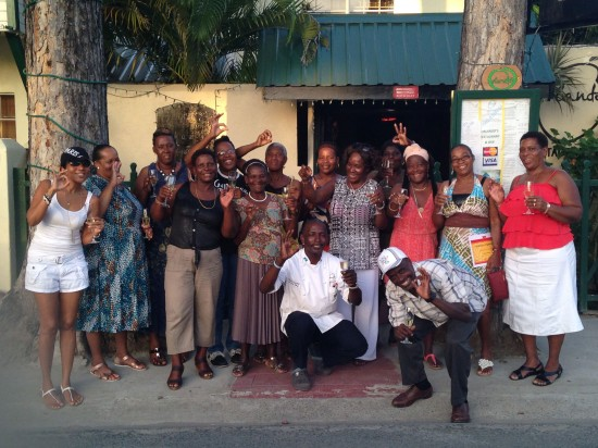 Chef Orlando poses for a photo with Soufriere market vendors.