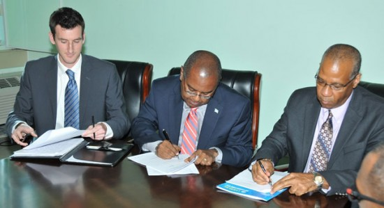 L-R: Roy Torbert of the Rocky Mountain Institute, Minister of Sustainable Development, Energy, Science and Technology Dr James Fletcher, and LUCELEC Managing Director Trevor Louisy sign the Integrated Resource Plan intended to design a viable energy transition strategy for Saint Lucia.