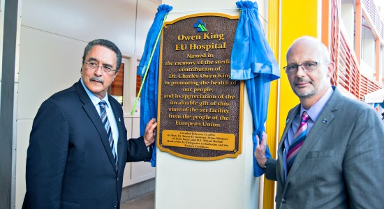 Prime Minister Kenny Anthony (left) and EU Ambassador Mikael Barfod unveil the official name plaque of the new hospital.