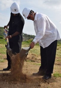 NIC Director Matthew Mathurin with Prime Minister Kenny Anthony performing the ceremonial sod-turning on Wednesday.