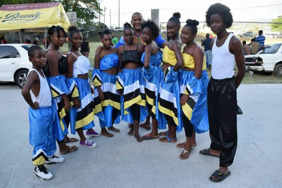 The SLPs Castries South hopeful Ernest Hilaire poses with aspiring dancers from Faux A Chaud in need of more than just hand-outs and selfies with politicians!
