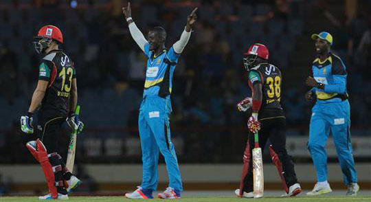 Daren Sammy and the St. Lucia Zouks, on their home turf, celebrate their victory over the St. Kitts Patriots.