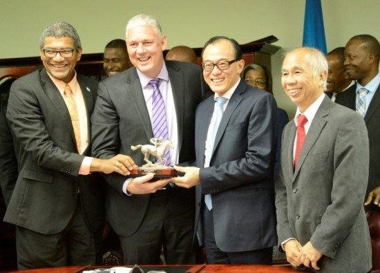 Billion dollar smiles; Choiseul MP Bradly Felix, PM Allen Chastanet, and representatives of DSH Caribbean Star Limited