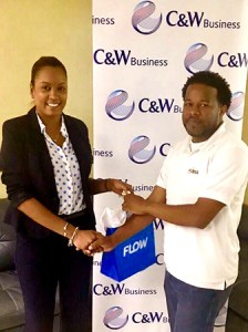 Alvin Jn Baptiste, SLASPA network administrator, was presented with an Alcatel MiFi personal hotspot by Dione Benn, Sales Manager for C&W Business