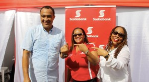 Oh Yes He Did!!! Dr. Christopher Tufton (left) proudly displays the finger where blood was taken for his HIV test. Sharing the moment are Hope McMillan Canaan (centre) and Dr. Denise Chevannes