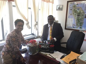 Dr. Lystra Fletcher-Paul, FAO Subregional Coordinator for the Caribbean presents Mr. Johnson Drigo, Dominica Minister of Agriculture and Fisheries, with farming supplies that can be used to stimulate Dominica's food production.