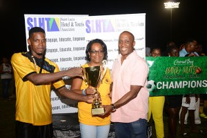 SLHTA Chief Operation Manager Presents Championship Trophy to Team Captain Anchus Charles, HR Manager Ms. Juliana Samuel looks on
