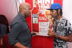 St Lucian Soca Star Ricky T (right) speaks with Senior Sales and Marketing Manager Dexter Percil at the launch of Campari's Win a Trip to Trini Carnival campaign