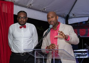 "Dexter Percil Senior Sales & Marketing Manager, PCD, addressing Campari ""Come Together"" launch as MC Money Ron looks on"