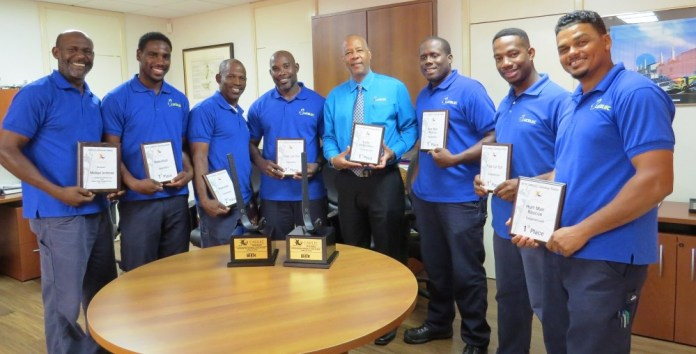 LUCELEC Managing Director Trevor Louisy with the company's Experienced Team (FROM LEFT) Voldon Hazell, Tomy Adolph and Alpheaus Alphonse