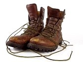 6395949-well-worn-pair-of-leather-workboots-on-a-white-background