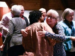 A hug between two members