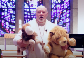 Interim Pastor David E. Mueller with Lenny and Leroy the lions