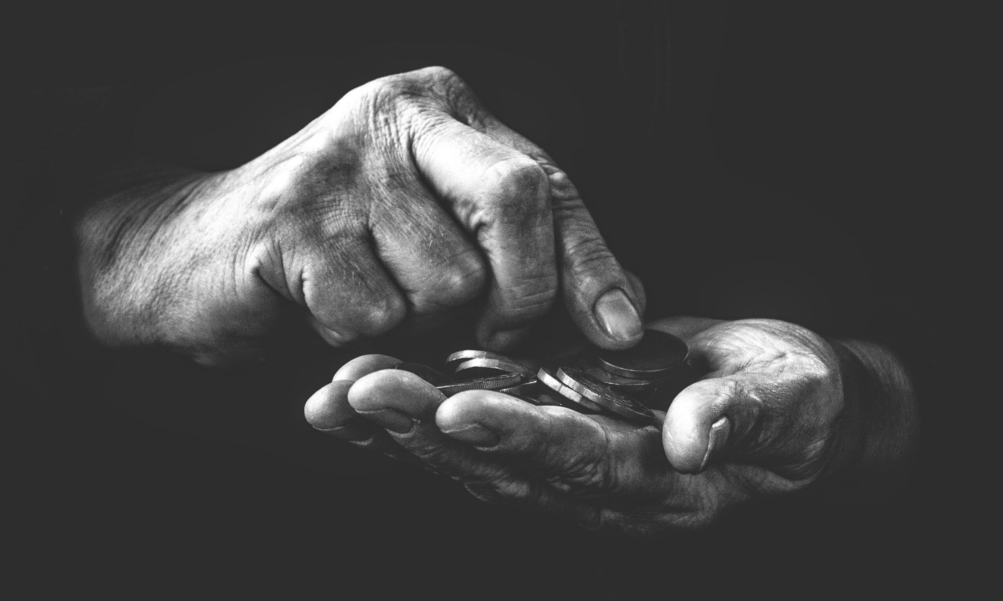 Hands with a few coins