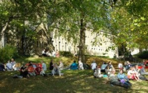 Conference attendees enjoy a picnic on St Mark's green during an autumn conference