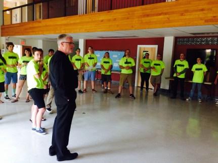 Fr. Rooney encouraging our teens before departure.
