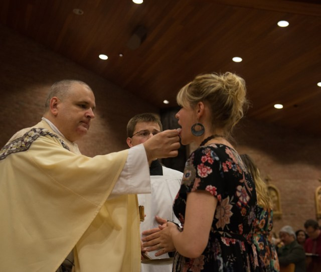 Father Mosimann Administers First Holy Communion