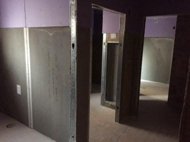 Looking into bathroom hallway