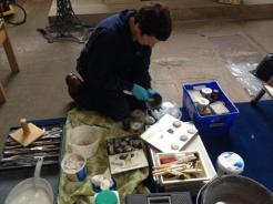Restorers mix mortar for repairs
