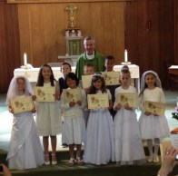 Father Tony and the children at the end of Mass