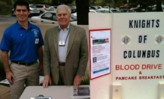 Blood drive and pancake breakfast- Knights David Lavelle and Bill Mathews manning the blood drive table after Mass