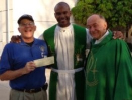 charity-haiti-Grand Knight Bill Uberti presents a check to Haitian Father Louis with Msgr. Dolan