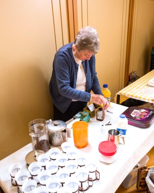 Volunteer serving tea in church