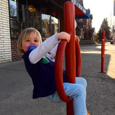Maggie on Red Bike Rack Thing