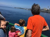 Bob and the kids look out on the sound from the ferry.