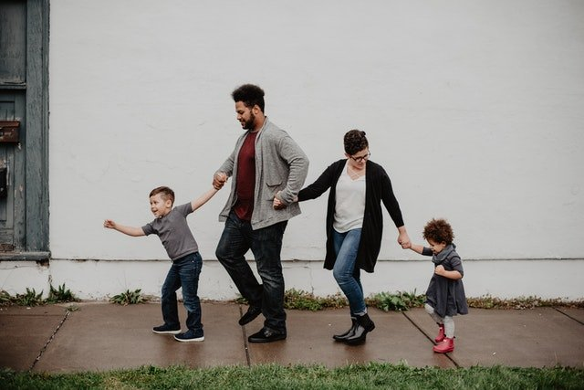 family-of-four-walking-at-the-street-2253879 3