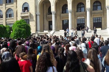 Turkish security guards beat students protesting gov't bill to divide Gazi University