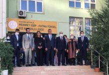 Spano posing with members of Turkey's ruling party